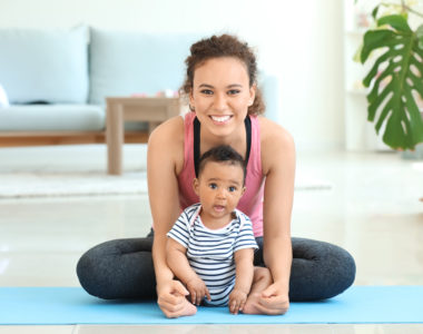 Mother & Daughter practicing yoga at home